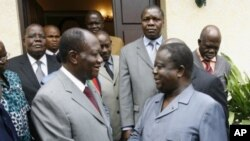 Alassane Ouattara (à gauche) et Henri Konan Bédié