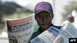 A vendor sells the privately-owned Daily News newspaper in Harare, March 18, 2011