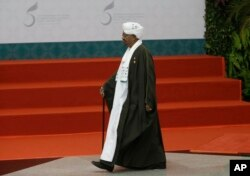 FILE - Sudan's President Omar al Bashir walks to the stage before a group photo session at the Organization of Islamic Cooperation summit in Jakarta, Indonesia, March 7, 2016.