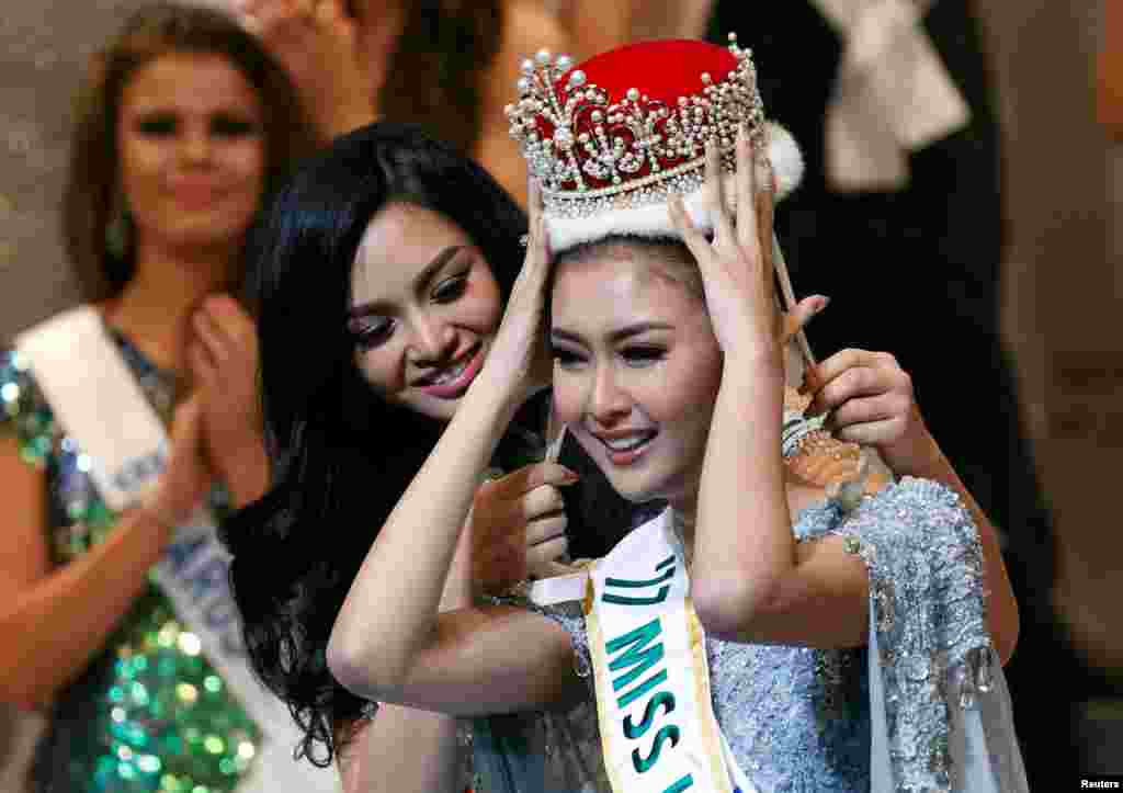 The winner of the Miss International 2017 Kevin Lilliana (R) representing Indonesia receives her crown from Miss International 2016 Kylie Verzosa representing Philippines at the 57th Miss International Beauty Pageant in Tokyo, Japan.