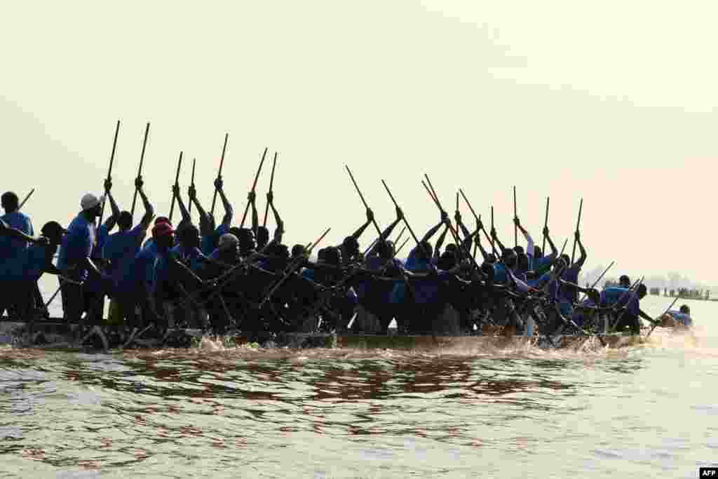A pirogue races on the Oubangui River in Bangui, Central African Republic, Dec. 1, 2020.