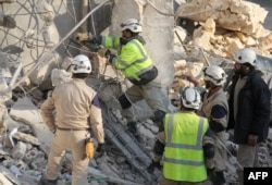 FILE - Syrian civil defense teams work on the rubble of a building in Idlib, in northwestern Syria, on Dec. 21, 2015, following reported Russian airstrikes.