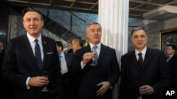 Montenegro's Parliament speaker Ranko Krivokapic, left, Prime Minister Milo Djukanovic, centre and President Filip Vujanovic toast to celebrate an invitation to join NATO, in Podgorica, Montenegro, Wednesday, Dec. 2, 2015. NATO's membership invitation to Montenegro represents a historic day for the tiny Adriatic state.