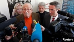 FILE - France's far-right National Front political party founder Jean-Marie Le Pen speaks to journalists at a news conference in Marseille, March 27, 2014.
