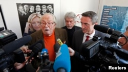 FILE - National Front political party founder Jean-Marie Le Pen speaks to journalists at a news conference in Marseille, March 27, 2014.