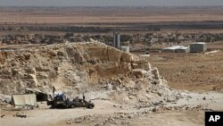 A frontline rebel position overlooks the town of Bir al-Ghanam in western Libya, August 5, 2011