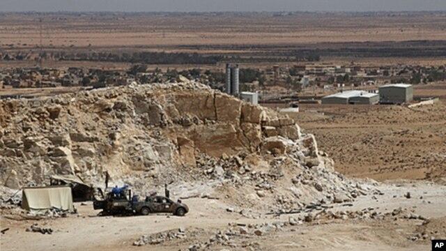 A frontline rebel position overlooks the town of Bir al-Ghanam in western Libya, August 5, 2011