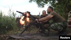 "FILE - Members of Ukraine's military fire a grenade launcher in this undated image. That military has asked the United States for 'lethal defensive weapons."" A revised GOP proposal calls for ""appropriate assistance."""