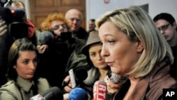 French presidential candidate, Marine Le Pen (R), president of the extreme right political party, leads the first round of public polls with 23 percent of the vote in Lille, northern France, March 5, 2011