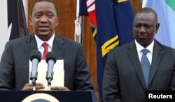 FILE - Kenyan President Uhuru Kenyatta, left, appears with his deputy, William Ruto, at a news briefing.