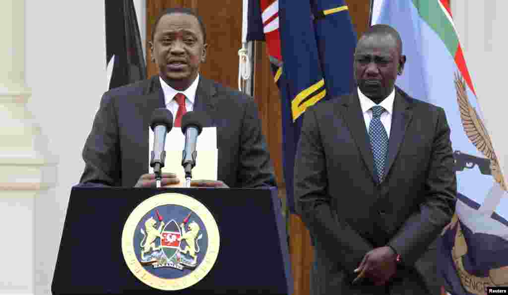 Kenyan President Uhuru Kenyatta, left, with Deputy President William Ruto, addresses a news conference at the State House in Nairobi, Kenya, Dec. 2, 2014.
