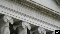 FILE - This May 4, 2021, photo shows the Treasury Building in Washington.