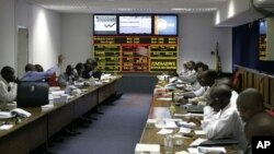 FILE: In this April 24, 2008 file photo, trading gets underway on the Zimbabwe Stock Exchange in Harare.