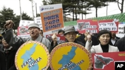 South Korean protesters rally against the annual joint military exercises between South Korea and the United States in front of the South Korean and United States War Command Center in Seongnam, South Korea, Feb. 28, 2011.