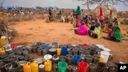 FILE - People wait for food and water to be distributed in the Werder zone of Ethiopia's Somali region, Jan. 28, 2017.