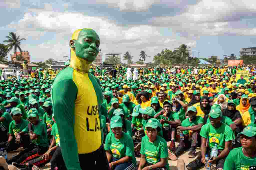 Supporters of the Tanzanian ruling party Chama Cha Mapinduzi (Revolutionary Party), gather at the Kibanda Maiti Stadium, during the last campaign rally in Stone Town ahead of the national elections.