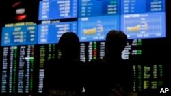 6月21日东京东京证券交易所电子股票交易板: 日本股市日经指数下跌0.6%