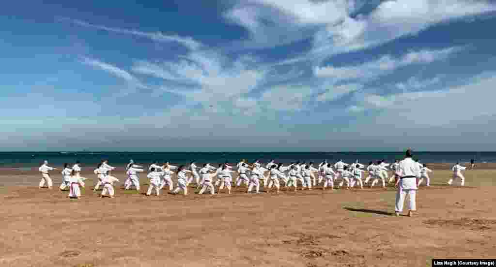 Members of the Seki Ryuzan Karate club demonstrate their skills during the 30th anniversary of the club on the Benllech beach in Benllech, United Kingdom.