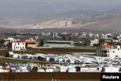 FILE - A general view shows an informal Syrian refugee camp in Tirbol village, Bekaa valley, Lebanon, March 10, 2016.