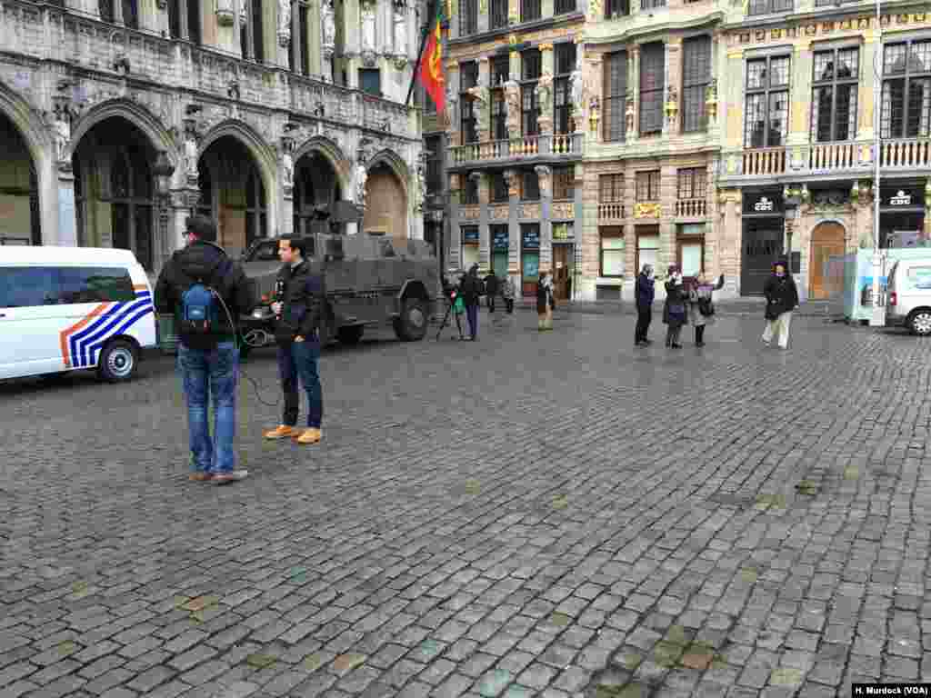 Tanks guard tourist centers in Brussels, Belgium, while journalists prepare to report on an event they hope will not happen.