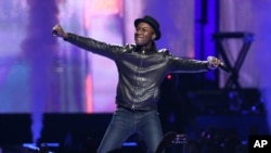 FILE - Singer-songwriter Aloe Blacc is seen performing on stage.