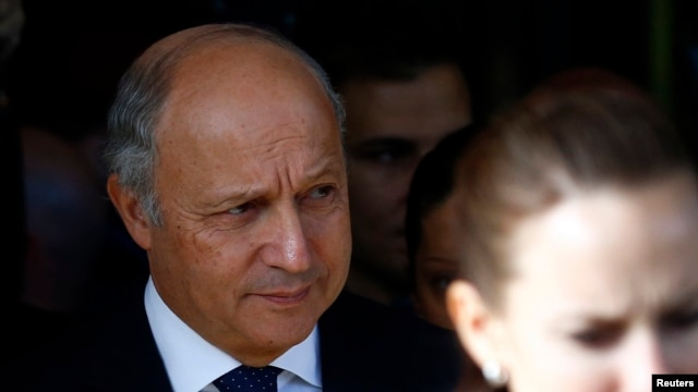 French Foreign Minister Laurent Fabius leaves the Intercontinental hotel on the third day of closed-door nuclear talks with Iran in Geneva November 9, 2013.