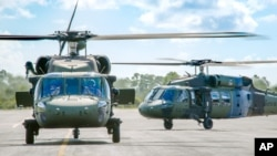 FILE - The Colombian Army flew two S-70i BLACK HAWK helicopters to Colombia following acceptance from Sikorsky's West Palm Beach, Florida, facility in late August.