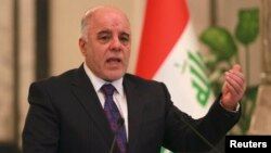 Iraq's Prime Minister-designate Haider al-Abadi gestures during a news conference in Baghdad, Iraq, Aug. 25, 2014.