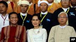 Myanmar's Foreign Minister Aung San Suu Kyi, center, sits with Myanmar's President Htin Kyaw, (Right), and Vice President Henry Van Hti Yu as they smile for a photo session following the Union Peace Conference-21st Century Panglong.