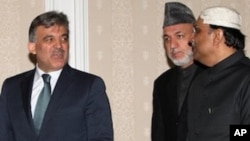 President of Turkey Abdullah Gul, left, and his counterparts Hamid Karzai of Afghanistan, center, and Asif Ali Zardari of Pakistan arrive for a Turkey-Afghanistan-Pakistan summit in Istanbul, Turkey, Friday, Dec. 24, 2010.