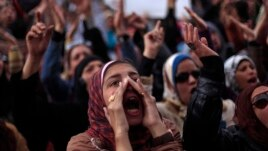 Egyptian protesters chant anti-government slogans during a rally in Tahrir Square, Cairo, Egypt, Feb. 1, 2013.