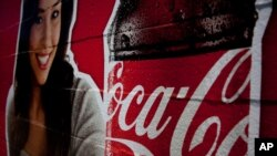 "FILE - Image shows a Coca-Cola advertisement, July 16, 2012. The Indian subsidiary of Coca-Cola Co (KO.N) said on Friday it may have to close some bottling plants if the government pushes through a proposal that would subject fizzy drinks to a 40 percent ""sin"" tax, as part of a broader fiscal overhaul."