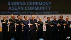 ASEAN leaders from left, Philippine President Benigno Aquino III, Singapore's Prime Minister Lee Hsien Loong, Thai Prime Minister Prayuth Chan-ocha, Vietnam's Prime Minister Nguyen Tan Dung, Malaysia's Prime Minister Najib Razak, Laos' Prime Minister Thongsing Thammavong, Brunei's Sultan Hassanal Bolkiah, Cambodia's Prime Minister Hun Sen, Indonesia's Prime Minister Joko Widodo and Myanmar's President Thein Sein join their hands as they pose for photographers after the signing ceremony of the 2015 Kuala Lumpur Declaration on the Establishment of the Association of Southeast Asian Nations (ASEAN) Community and the Kuala Lumpur Declaration on ASEAN 2025, in Kuala Lumpur, Malaysia, Sunday, Nov. 22, 2015. (AP Photo/Lai Seng Sin)