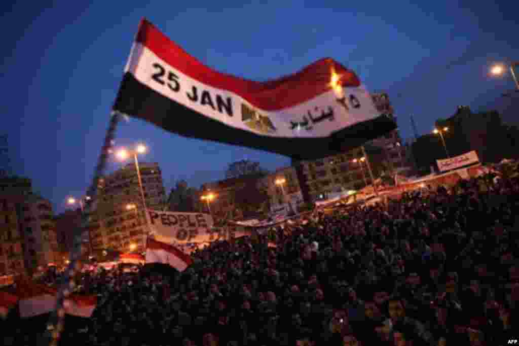 A flag is waved by anti-government protesters as they demonstrate in Tahrir Square in downtown Cairo, Egypt Thursday, Feb. 10, 2011. Thousands of state workers and impoverished Egyptians launched strikes and protests around the country on Thursday over th