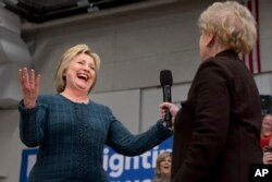 Democratic presidential candidate Hillary Clinton reacts as former Secretary of State Madeleine Albright introduces Clinton at a campaign event at Rundlett Middle School, in Concord, N.H., Feb. 6, 2016.