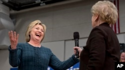 Democratic presidential candidate Hillary Clinton reacts as former Secretary of State Madeleine Albright introduces Clinton at a campaign event at Rundlett Middle School, in Concord, N.H., Saturday Feb. 6, 2016.