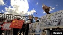 Des manifestants protestent contre le braconnage de rhinocéros à Pretoria, Afrique du Sud, le 29 mars 2012.
