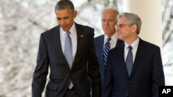 Federal appeals court judge Merrick Garland, walks out with President Barack Obama and Vice President Joe Biden as he is introduced as Obama's nominee for the Supreme Court during an announcement in the Rose Garden of the White House, in Washington, Wednesday, March 16, 2016. (AP Photo/Andrew Harnik)