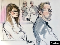FILE - Actor Lori Loughlin, left, appears in this court sketch at a hearing for a racketeering case involving the allegedly fraudulent admission of children to elite universities, at the U.S. federal courthouse in downtown Los Angeles, California, March 13, 2019.