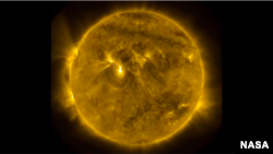 Solar activity is seen in a screenshot of a NASA video.