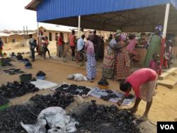 Burundian Refugees in selling charcoal in Mahama Refugee camp in Rwanda.