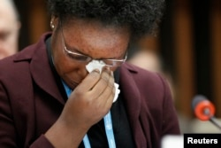 FILE - Health worker and Ebola survivor from Sierra Leone Mme Rebecca Johnson cries after addressing the media during a special meeting on Ebola at the WHO headquarters in Geneva, Jan. 25, 2015.
