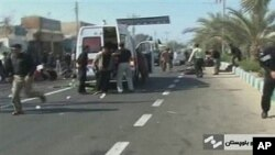 An ambulance attends the scene of a bomb blast in this image taken from TV, in Chahbahar Iran, 15 Dec 2010