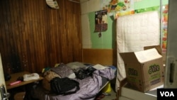 A bedroom for several people who have sought refuge is seen at the church, Johannesburg, South Africa, May 8, 2015. (Gillian Parker/VOA)