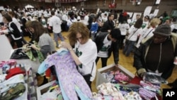 Volunteers for The Salvation Army sort children's pajamas for donation at a Greater Philadelphia Martin Luther King Day of Service event at Girard College in Philadelphia, January 17, 2011.