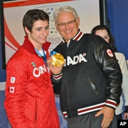 From left: Scott Moir, British Columbia Premier Gordon Campbell and Tessa Virtue