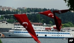 Turkish aid ship, the Mavi Marmara, is seen in Istanbul, Turkey, Monday, May 30, 2011. Pro-Palestinian activists marked the first anniversary of a deadly raid by Israel on a Turkish aid ship bound for the Gaza Strip by gathering on the deck of the same bo