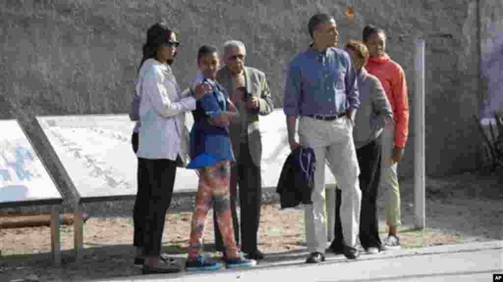 Ahmed Kathrada, a former prisoner with Nelson Mandela, guides Barack Obama through Robben Island prison, South Africa