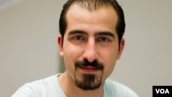 FILE - Bassel Khartabil, taken from the street in Damascus in March 2012 amid a wave of military arrests, has been executed in prison, his widow says.