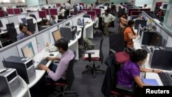 Workers are seen at their workstations on the floor of an outsourcing centre in Bangalore, February 29, 2012.